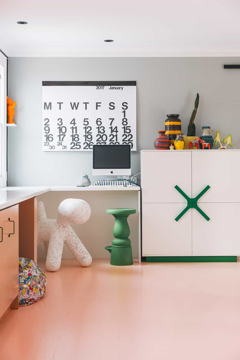 OPPOSITE West German pottery can also be found in the office, along with a beanbag from Kip & Co, a Puppy chair by Eero Aarnio for Magis and a cabinet by Karim Rashid for BoConcept.