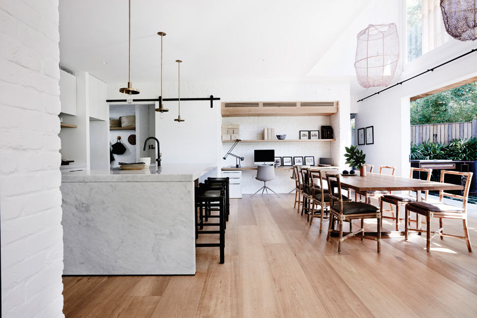 KITCHEN The kitchen joinery was a real labour of love. American oak veneer was wire brushed then given five coats of white paint and sealed before the desired finish was achieved. The Barn lights above the Carrara marble island were designed by Romy Alwill and the Strapped stools were a collaboration between Romy and Robert Plumb; all are now available from Specified Store. The open shelving holds a dinner set custom-made by potter Cameron Williams.