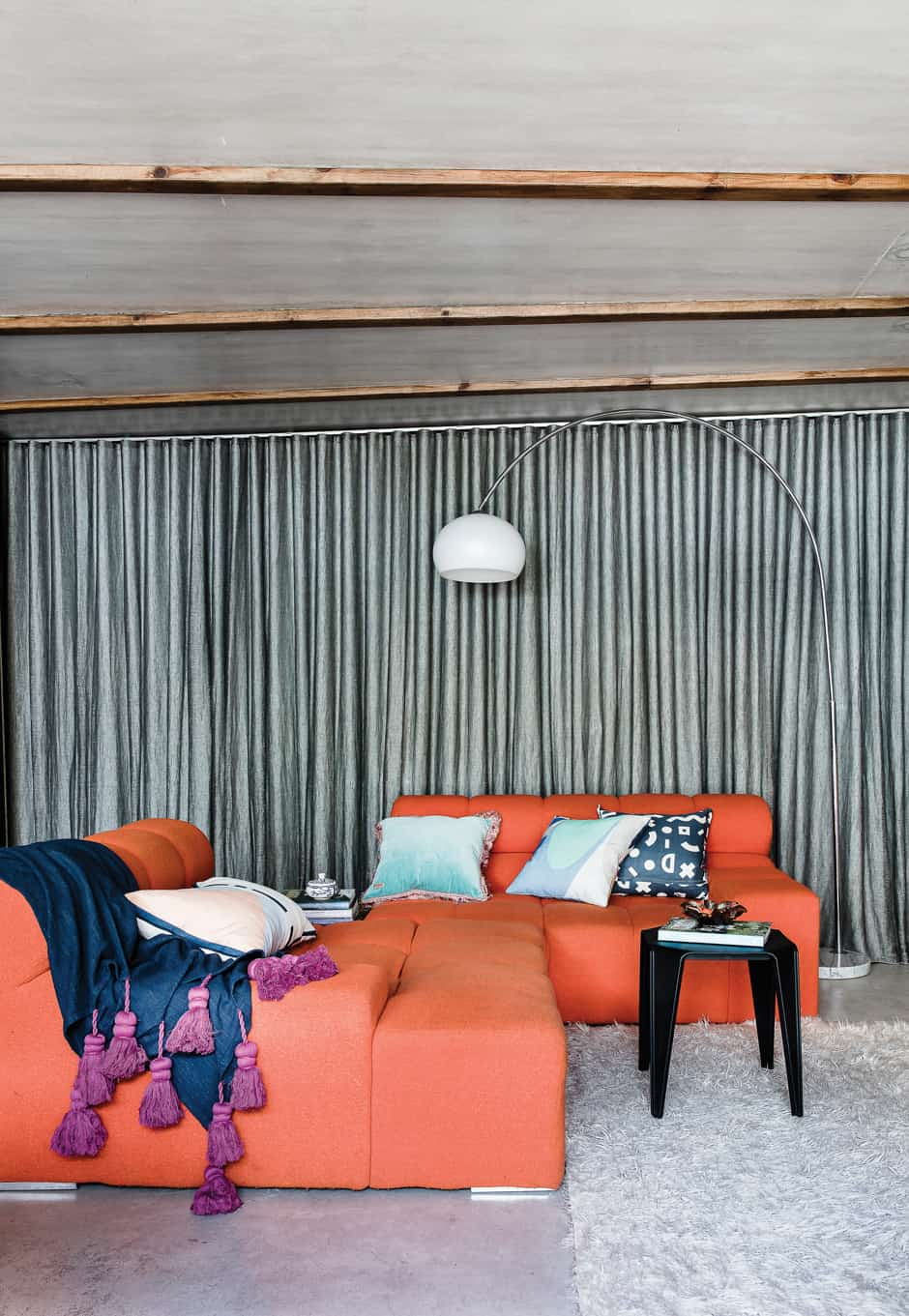 LIVING A sheer linen curtain creates a sense of privacy while letting in a little light, while the Tufty-Time sofa designed by Patricia Urquiola for B&B Italia provides a colourful retro element teamed with cushions from Life Interiors and a Kip & Co throw. On the shelf is the self-portrait by Susanna's mother (far right) that inspired Susanna to take the plunge into illustrating; the purple piece beside it is by New Zealand artist Tracey Tawhiao.