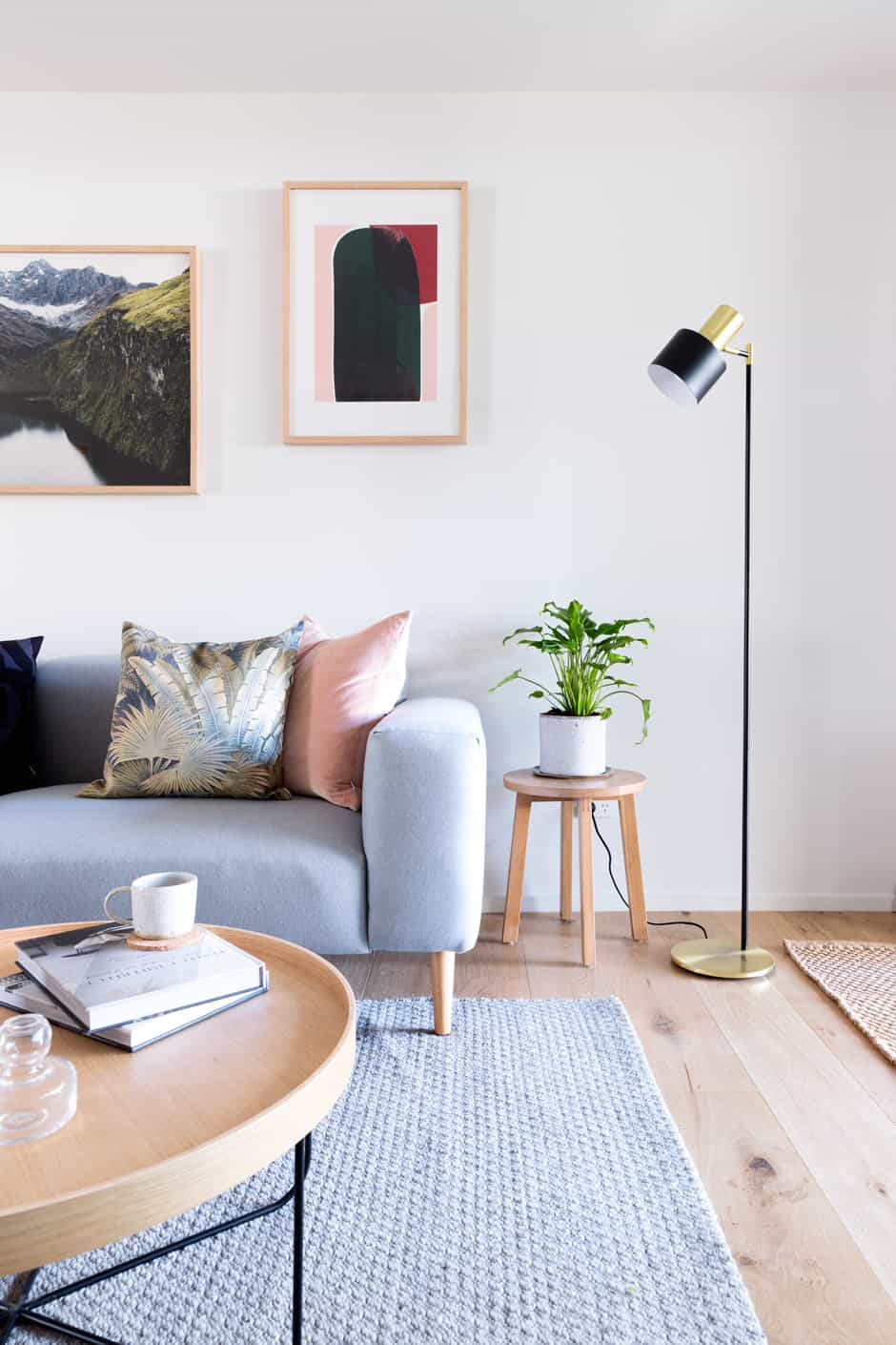 LIVING Photographic artwork South (left) by Brooke Holm and No 14 by Berit Mogensen Lopez hang above a sofa and coffee table from Città. The floor lamp is from Lighting Direct, and the Sherpa Weave rug by Armadillo & Co is from The Ivy House.