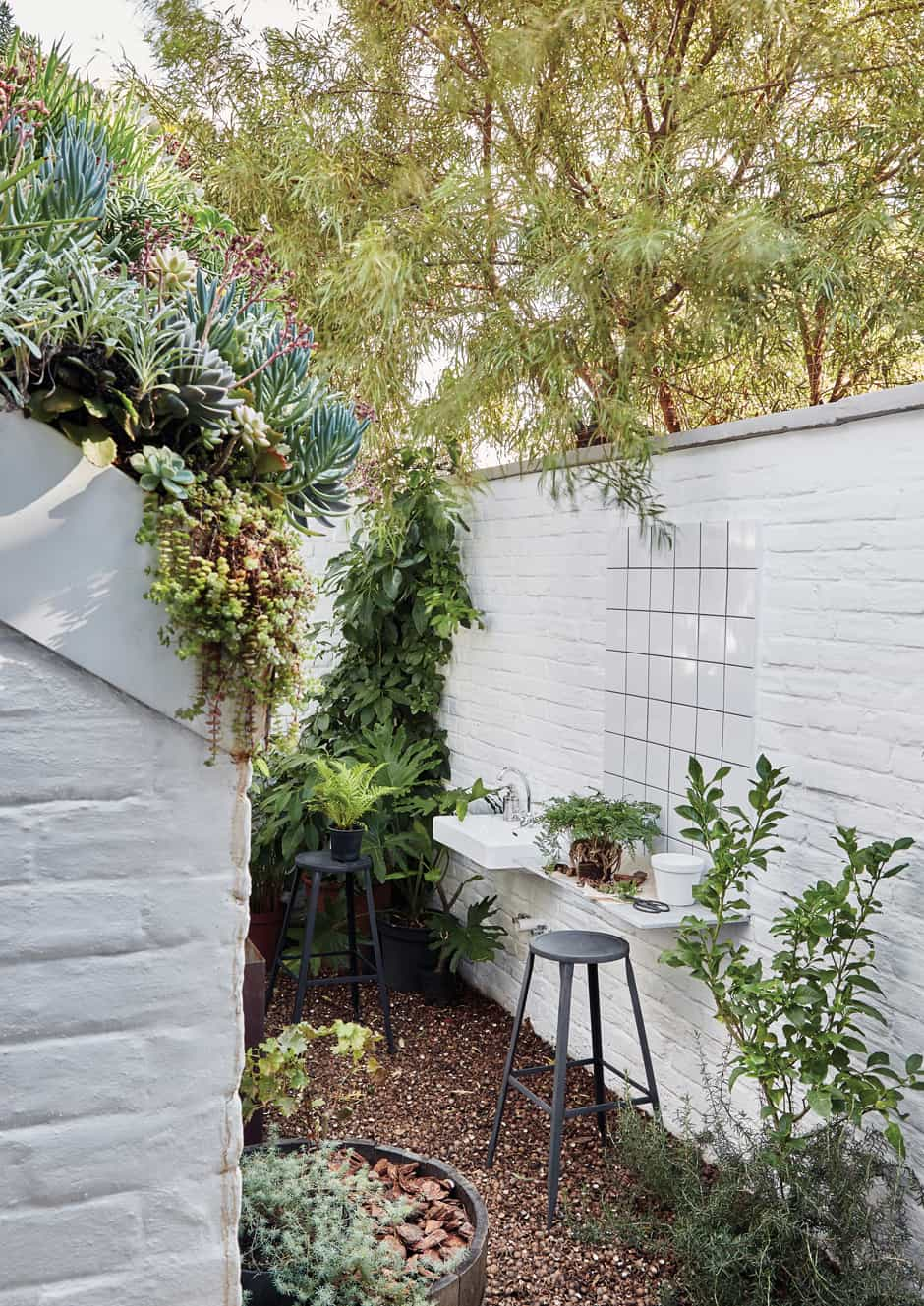 KITCHEN GARDEN Herbs thrive in this area, where a wall-mounted planter helps to maximise space. This courtyard also features a pizza oven and a roof garden overflowing with succulents.