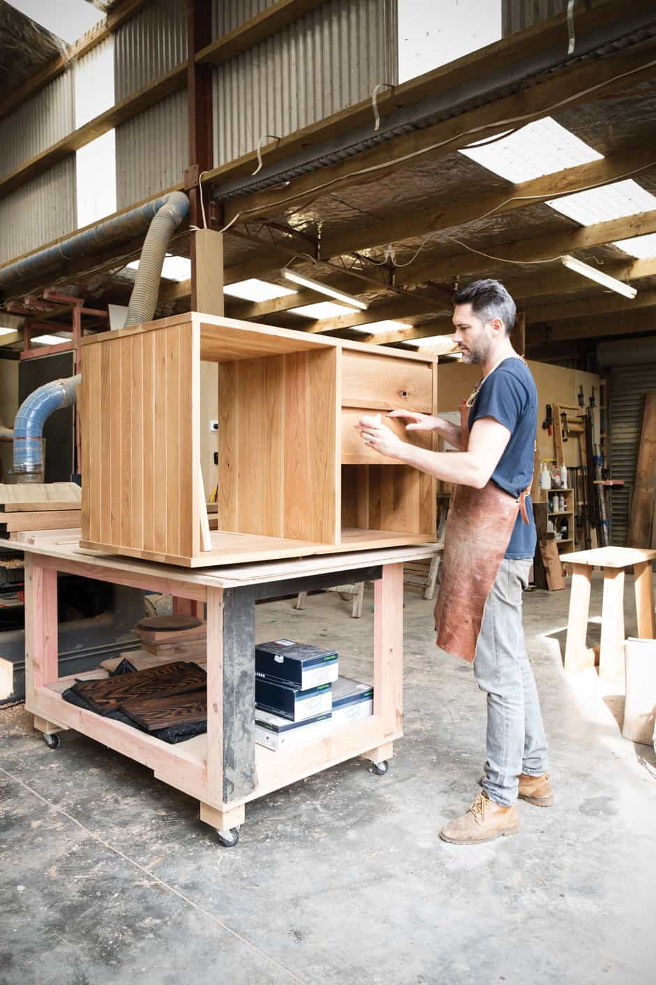 MEN AT WORK Will and Faustin get down to business. Wherever possible, the bespoke pieces they make are crafted from recycled and sustainably sourced timber, which is often customised with other materials including steel, copper and leather.